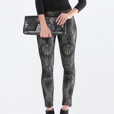 """Bebe Bonded Lace Leggings Size S/P Calling all curves!! These are a great pair of Bebe bonded lace ponte leggings in a size S/P.  They feature bonded lace kicked up a notch with shimmering metallic underneath.  They are made of 100% polyester & the measurements are 11.5"""" rise; 29"""" inseam; 10"""" leg opening & the waist is 26"""" around.  The waist is elastic & the pants do have stretch.  Worn only once they are in excellent condition. bebe Pants Leggings"""