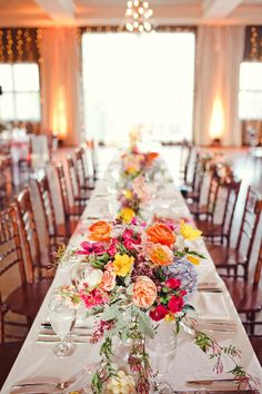Colorful floral centerpieces take the center spotlight at this iconic Texas wedding at Hotel Ella, a historic boutique hotel in Austin, Texas.