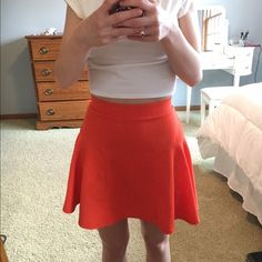 SALE Orange circle skirt! Orange circle/skater skirt. Originally bought at Macy's from the Material Girl line by Madonna and her daughter, Lourdes. Perfect condition. Fits pretty tight, even though it's a small, it fits like an extra small. Gold zipper with black trim up the back. Super cute! Love the product but not the price? Make an offer, I'll consider all offers :) Material Girl Skirts Circle & Skater