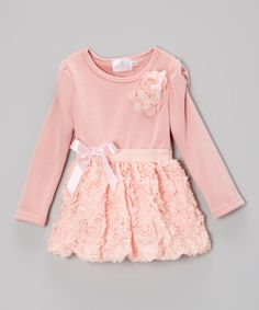 It's easy for girls to look stylish when this darling dress comes out of the wardrobe. Precious petals dot the bottom and classic pearls intertwine into a flower appliqué to create a unique look fit for a miniature maven of fashion.