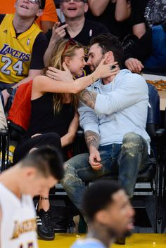 Celebrities on the Kiss Cam - Famous People Kissing at Sports Games - Elle