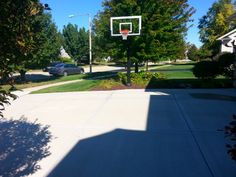 This front view shot shows a Pro Dunk Gold Basketball system installed at this Naperville, Illinois home, just outside Chicago. The wide driveway allows for ample practice room.
