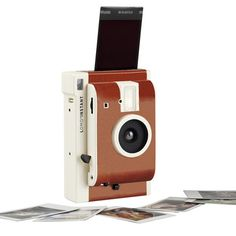 The people at Lomography do as much as anyone to keep analog photography alive — so we couldn't think of anyone better to make an all-new instant system. The Lomo Instant Camera features a retro-styled body in one of four. Unique Wedding Gifts, Chic Wedding, Lomography Instant, Concours Photo, Close Up Lens, Multiple Exposure, Gadgets And Gizmos, Tech Gadgets, Gifts For Photographers