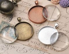 Crafts supplies:  http://www.sunandmooncraftkits.com/blank-pendant-trays/30mm-circle-pendant-trays.html
