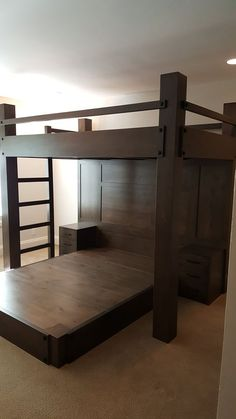 custom full XL loft bed over queen platform bed. Features paneled back wall with two integrated night stands, one on either side of the queen platform bed. Made of rustic alder with a custom driftwood finish.