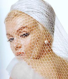 I love the large fishnet over Marilyn's face.