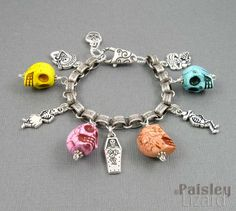 "Day of the Dead sugar skull charm bracelet by PaisleyLizardDesigns. With silver book chain from B'sue Boutiques. This chain is perfect for charm bracelets - it lets all the charms hang in the ""right"" direction."