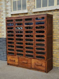 Antique haberdashery cabinet with 40 curved glass drawers with original handles. 3 large drawers below.  origin: UK  year: 1920
