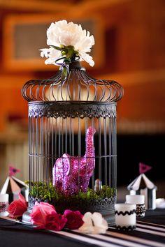 Glittery elephant inside a birdcage as a centerpiece!