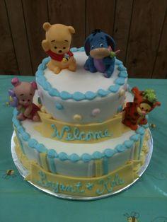 Homemade twin boys Winnie the Pooh baby shower cake.