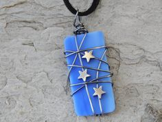 Check out this item in my Etsy shop https://www.etsy.com/listing/259294792/blue-glass-pendant-with-hematite-star