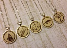 silver tone necklace with your choice of faction symbol from the Divergent book series