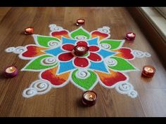Here is a quick and easy freehand flower rangoli designs with colours for diwali. It is based on one of my original rangoli designs and I have tried to do so. Rangoli Designs Latest, Rangoli Designs Diwali, Rangoli Designs Images, Rangoli Designs With Dots, Diwali Rangoli, Beautiful Rangoli Designs, Simple Rangoli, Mehandi Designs, Free Hand Rangoli Design