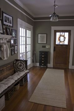 I love the idea of a church pew for an entryway bench