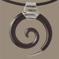 Spiral Horn Pendant - Tribal Jewelry -Tribal Spiral Jewelry - Horn Necklace - Horn Jewelry - Unique Jewelry  Spiralled horn pendant, tipped off in silver.  The spiral represents evolution and holistic growth.   Pendant Size: 30mm  Don't forget to choose which leather chain you like to add to the pendant.  $44