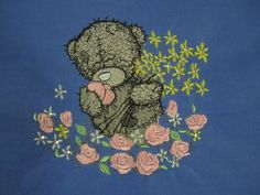 Teddy bear and the sea of flowers machine embroidery design