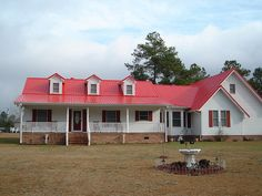 Red tin roof...could be our house with an addition added!!!