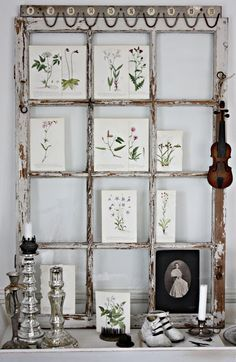 Like this idea of using small botanical prints in each pane of old window frame