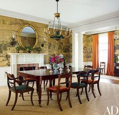 A de Gournay wallpaper lines the dining room, which hosts a Regency table and chairs; the gilt-wood chandelier is from TheronWareHudson, the George III mirror is from Cove Landing, and the sisal rug is by Beauvais Carpets.