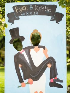 Cute wedding photo booth idea with a stand-up newlywed cutout