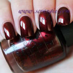 OPI German-icure by OPI. A dark, vampy, brown-tinged shimmery red. Looks velvety and shiny, not too dark, not too bright, ever so slightly metallic-shiny and even has a subtle gold shift to it. I always love these types of colors, and this one reminds me a tiny bit of La Boheme!