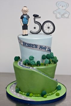This recent bicycle themed birthday cake we created here at our Gainesville, Florida bakery features a fondant figurine and custom bicycle topper. Bicycle Cake, Bike Cakes, Birthday Cakes For Men, 50th Birthday Cake Images, Birthday Ideas, Cupcakes, Cupcake Cakes, Mountain Bike Cake, Mountain Biking