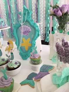Cupcakes and mermaid tail cookies at a mermaid birthday party! See more party ideas at CatchMyParty.com!