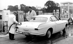 Vintage Cars Classic Roger Moore watches a garage attendant fill The Saint's trademark Volvo with petrol in 1962 - The actor, most famous for his seven 007 movies, has died at the age of Here we look back at his life and career. Volvo P1800s, Volvo Cars, Roger Moore, The Saint Tv Series, Celebrity Cars, Classy Cars, Ford, Classic Movie Stars, Old Tv