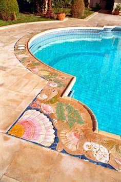 Hand made tile pool borders by Craig Bragdy Design.