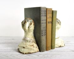 like this - old cast iron claw-foot tub feet repurposed as bookends ...