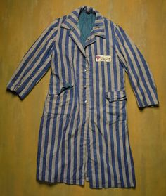 The Nazi Persecution of Jehovah's Witnesses artifact - uniform coat from death camp.  They were persecuted because of their neutral stand on war, in obedience to Jesus Christ.   - Matthew 26:52. ; Luke 6: 27,28...see also Isaiah 2:2-4
