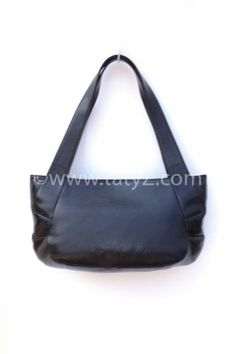 Black leather handbag by TATYZ