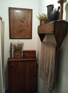 Old toolbox hung upside down to use as towel bar. Cute idea!