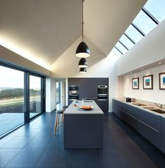 Glass / Isle of Skye House. Not crazy about the deisgn, but the architecture is spectacular. Love the vaulted ceiling and skylights, opposite the wall window.