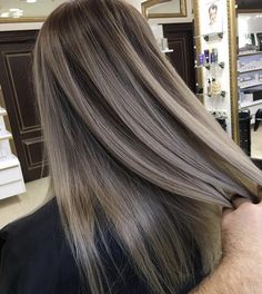 Dark ash blond with almost silver tones to take out the warmth of the light brown dark ash blond hair.