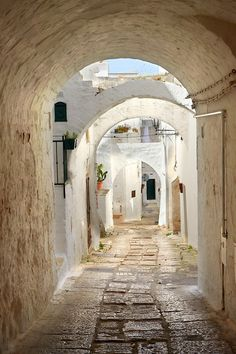The medieval narrow streets of Ostuni, The White Town, Puglia, Italy.