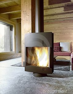 images of rooms with modern wood stoves | Modern Stove In The Living Room Stock Images - Image: 21163114