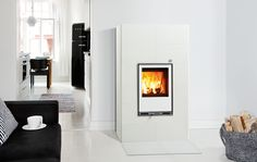 It's such a cold, cold world. Tulikivi makes heat-retaining fireplaces and stoves, sauna heaters as well as interior stone for counter tops, flooring, etc. Exterior Design, Interior And Exterior, Water Heating Systems, Soapstone, Countertops, Sweet Home, New Homes, House Styles, Inspiration
