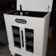 Comvert an Old Radio Cabinet Into a Wine Cabinet - This old radio cabinet was up cycled into something useful. A new wine cabinet! See the detail at Thrifty Tre…