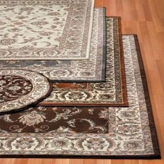 Elegance and warmth blossoms from these luxury rugs which includes a 4-piece set.