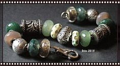 The oak leaf barrels were from Russia, with Trollbeads and artisan stones Love the Barrels!!!! By Deborah Taylor