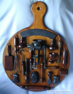 Vintage kitchen tools on display on wood board.  Nice way to show off a collection.