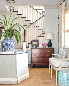 I'm in love with this entryway by @amylberry from this month's @southernlivingmag I'm trying to figure out how to get that wall color in my own house!