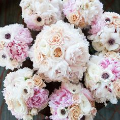 Brides.com: This Week's Best Wedding Ideas: April 4, 2014. A blend of cream-and-ivory peonies and heirloom pink roses (created by Cori Cook Floral Design) made gorgeous bridesmaids bouquets. Additional pink blooms and anemones set the ribbon-wrapped flowers apart from the bride's similarly lush bouquet.   See more photos from Caroline and Brad's classic Denver, Colorado wedding here.