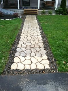 Walkway I made with Pathmate concrete molds. Very time consuming and labor intensive but I'm happy with the result.