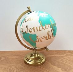 Hand painted globe, Quote globe, What a wonderful world globe, hand lettered, teal white and gold by DanielleContiArt on Etsy https://www.etsy.com/listing/260145496/hand-painted-globe-quote-globe-what-a