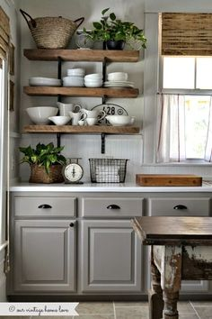 Comfy U-shaped cooking area with open shelving by Altlanta-based Carter Kay Interiors (through Desire to Inspire).