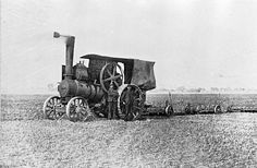 [A steam traction engine pulling three ploughs, Werribee, 1910.]