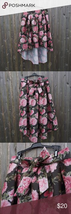NWT Bold Floral High-Low Skirt 🌸 RUE 21 Be beautiful and bold with this statement piece skirt! Perfect for spring formals! High-low style. Pleated. Adjustable bow on back of skirt. NEW WITH TAGS!! Smoke-free home.  Measurements: Waist: 16.5in wide  Shortest part of skirt: 24in long Longest part of skirt: 27in long  FIRM PRICE. Rue 21 Skirts High Low