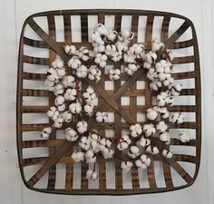 """27"""" Tobacco Basket with a 23"""" Cotton Wreath. Great for a rustic farmhouse look in any space. Available in the shop. $125"""